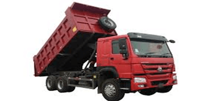 A dump truck carries loose materials for construction
