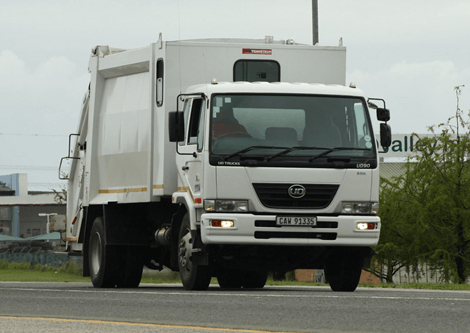Rear loader garbage truck for commercial waste management