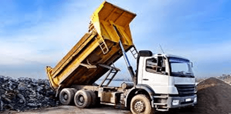 The dump truck is powered by a hydraulic hoist system to lift the dump box