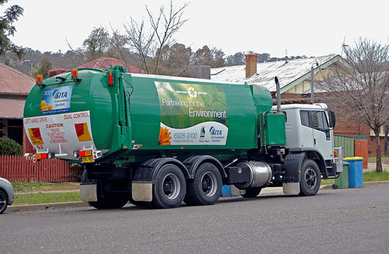 Automatic side loader garbage truck for residential properties